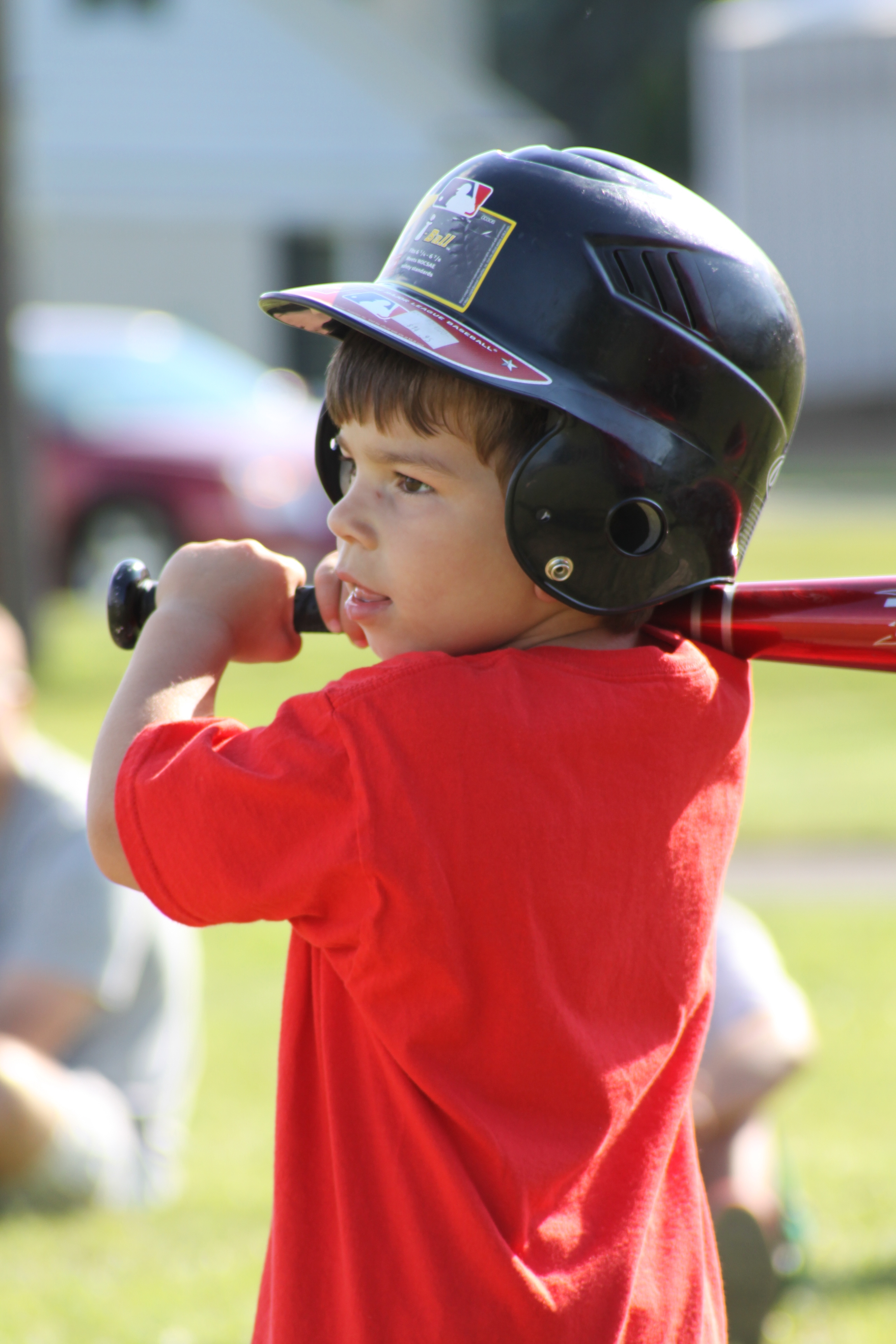 Baseball kid swinging